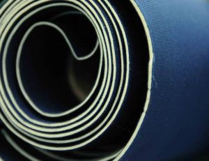 roll of navy blue neoprene fabric