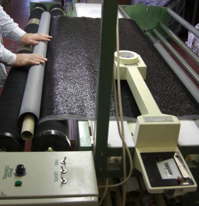 Rolling fabric with fabric rolling machine