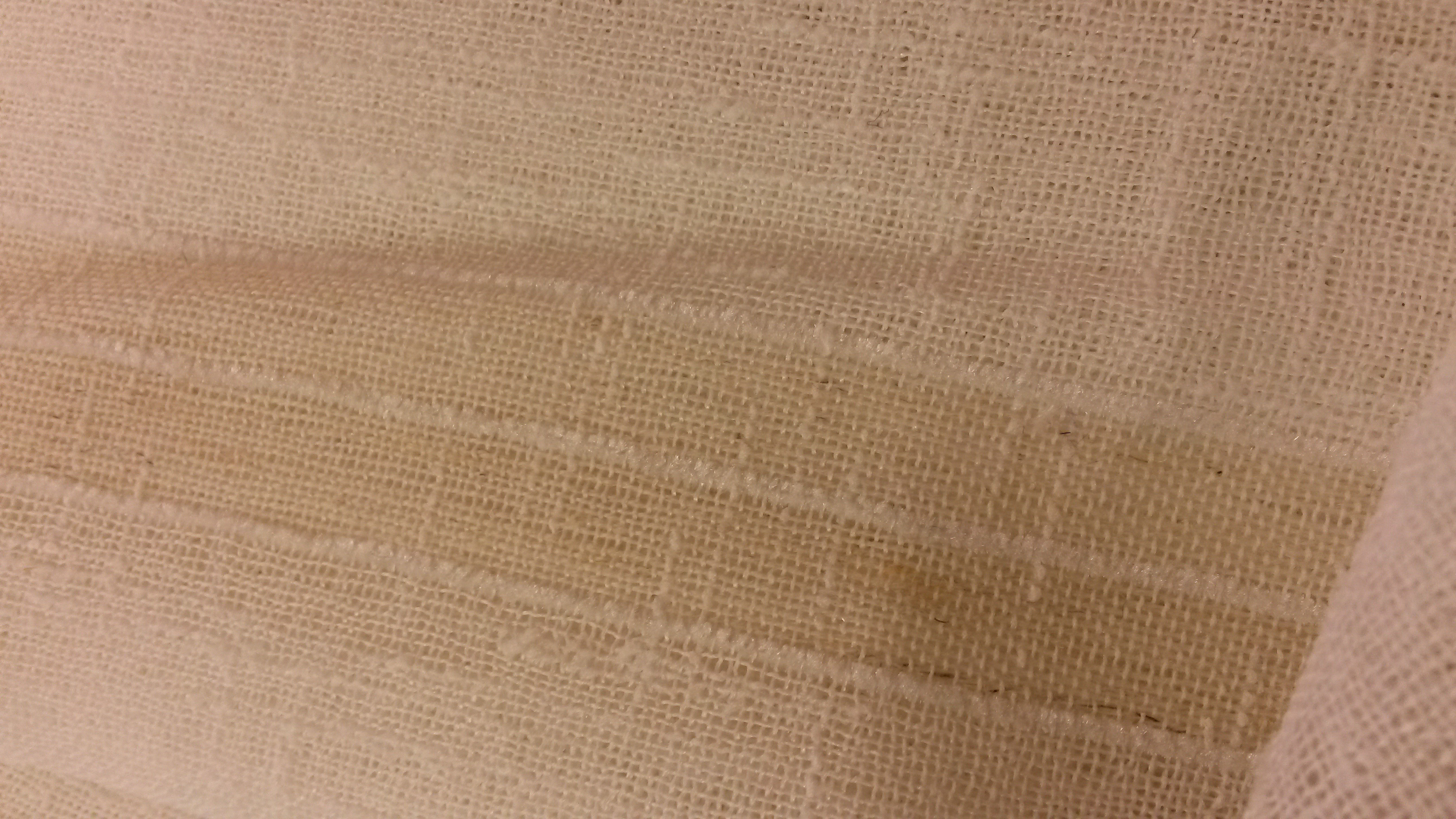As you can see, our boucle stripe polyester and linen voile fabric (KBT3871) has slight lines of irregularity on the surface because of the curled boucle yarns which gives a subtle and appealing texture