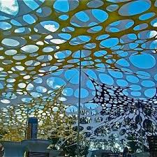 yellow and white canopy with holes