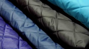 black navy turquoise purple quilted waterproof fabric