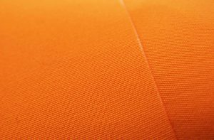 close up of orange acrylic awning fabric