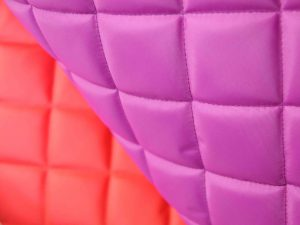 cerise and red quilted waterproof fabric