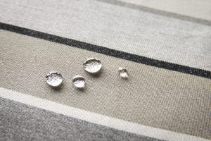 Waterproof fabric or water repellent