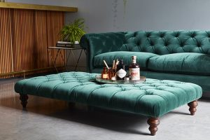 bottle green velvet chesterfield sofa and pouffe table