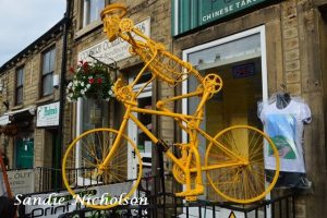 yellow man on bike decoration yorkshire