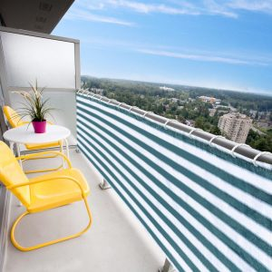 striped awning as balcony shade and privacy