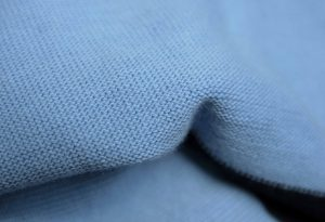 close up of jersey knitted tubular fabric sky blue