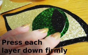 making glitter fabric cats eyes