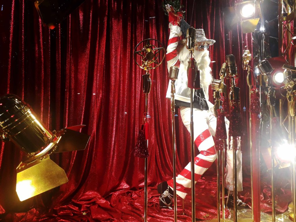 Rock star Santa candy stripe suit Christmas window 2018