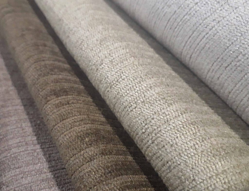 Warm neutral shades of Pebble, Dessert, Taupe and Mink Topaz upholstery fabric