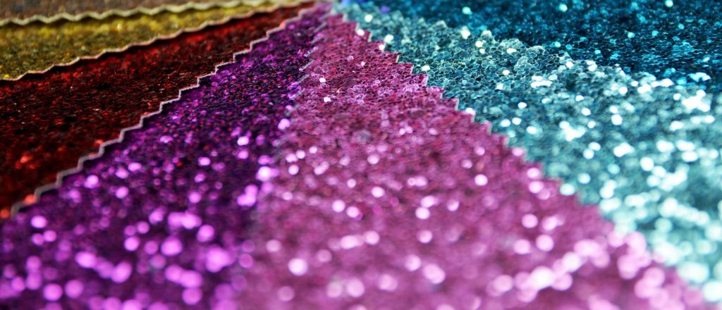 samples of coloured glitter fabric