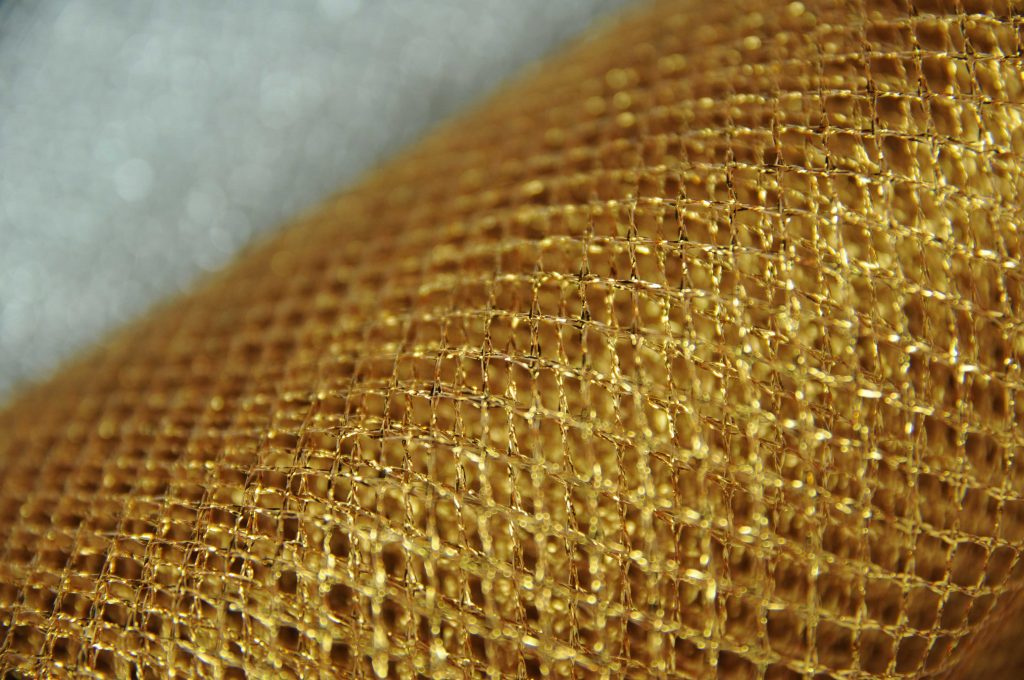rich gold fishnet glitter mesh net fabric non stretch metallic twinkling gold for Christmas party wear display merchandising