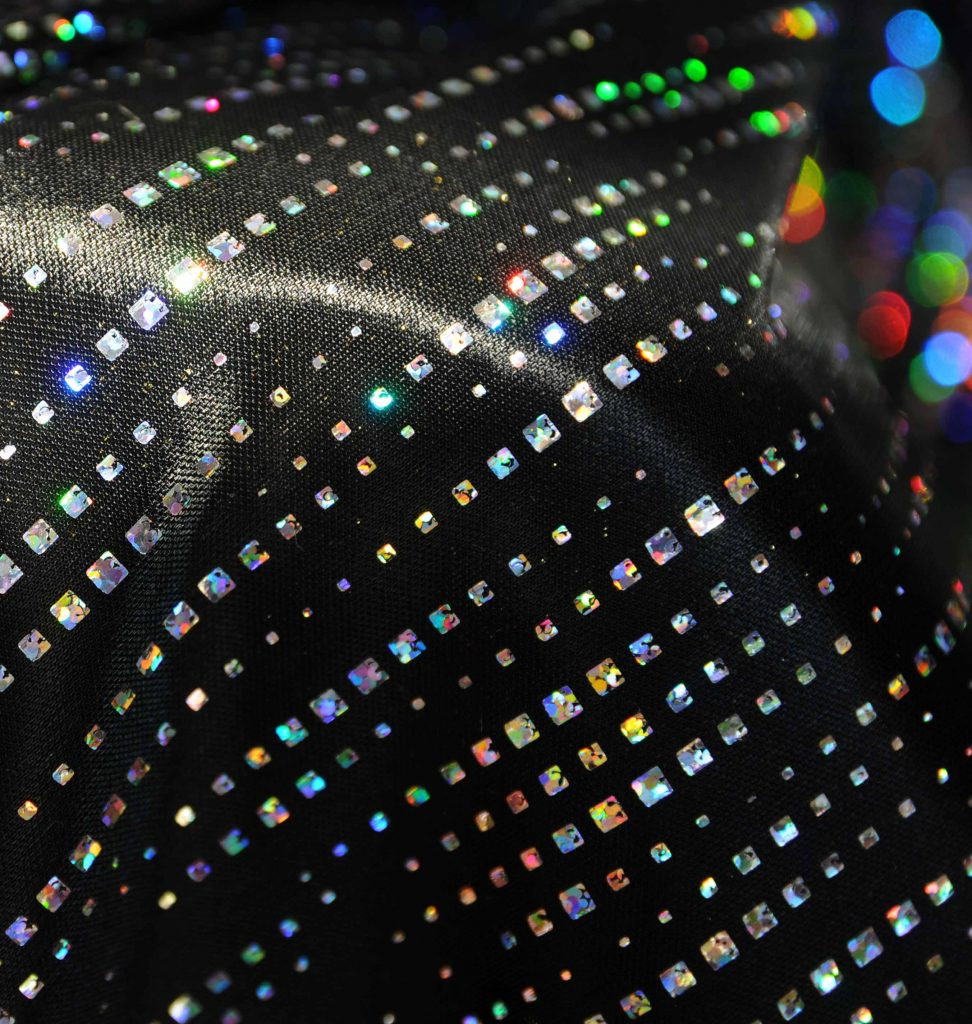 holographic cyber streak dotted lines design  on black satin polyester fabric rave wear display hologram silver