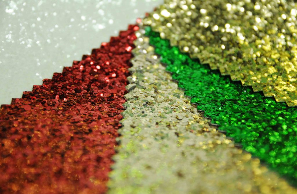 Christmas colours red green gold white glitter fabric for display