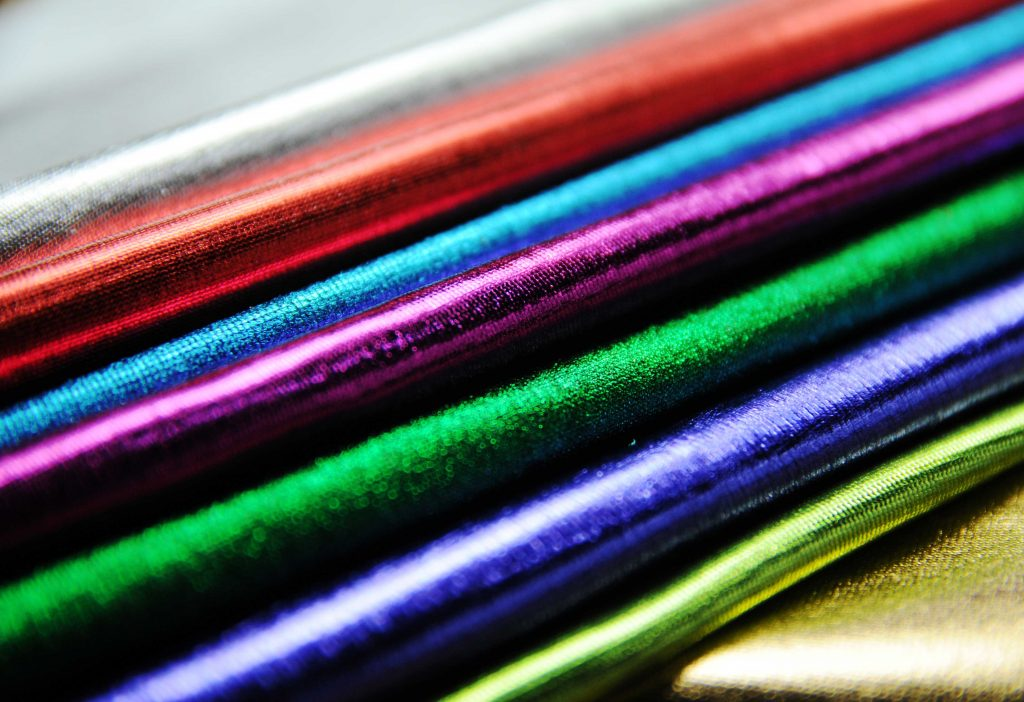 collection of coloured metallic stretch elastane lycra fabric for dance wear display christmas new year party wear clubbing beachwear