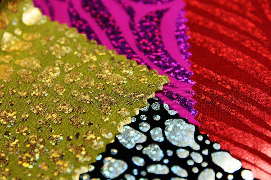 samples of various holographic lycra fabric